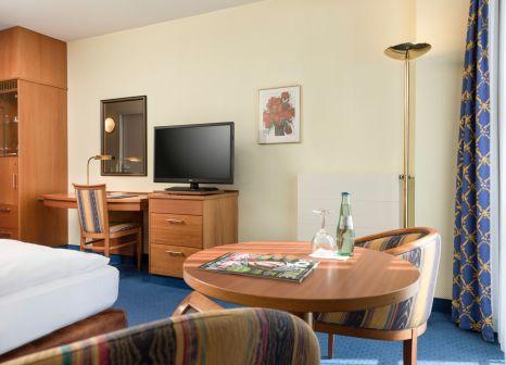 Hotelzimmer mit Mountainbike im Radisson Blu Hotel, Halle-Merseburg