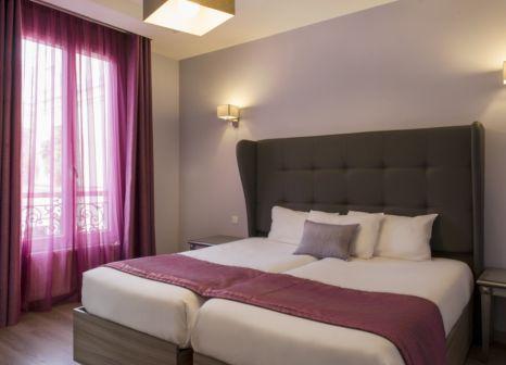 Hotelzimmer mit Geschäfte im Hôtel Mirific