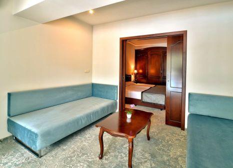 Hotelzimmer mit Mountainbike im Grifid Hotel Bolero