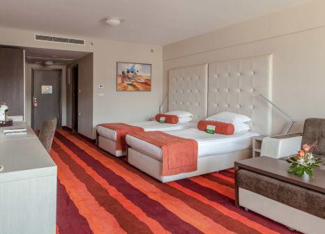 Hotelzimmer mit Mountainbike im International Hotel Casino & Tower Suites