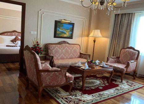 Hotelzimmer mit Mountainbike im Grand Hotel Saigon