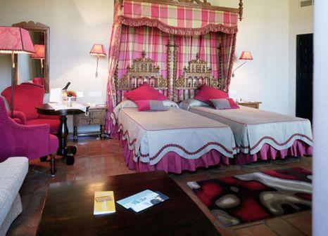 Hotelzimmer mit Hochstuhl im Parador de Zafra