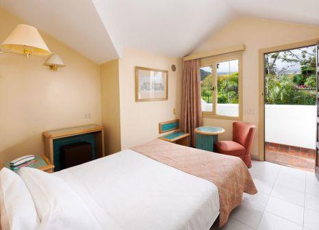 Hotelzimmer mit Mountainbike im Hotel Parque San Antonio