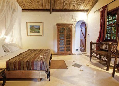 Hotelzimmer mit Mountainbike im Lakaz Chamarel Exclusive Lodge