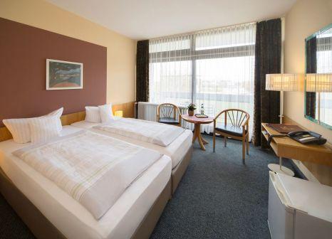 Hotelzimmer mit Mountainbike im Reichel's Parkhotel