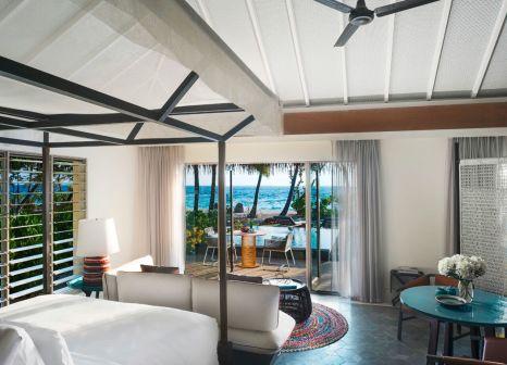 Hotelzimmer mit Tischtennis im InterContinental Maldives Maamunagau Resort