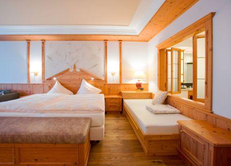 Hotelzimmer mit Mountainbike im Alpenresort Schwarz