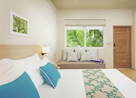 Hotelzimmer mit Tischtennis im Malahini Kuda Bandos Resort
