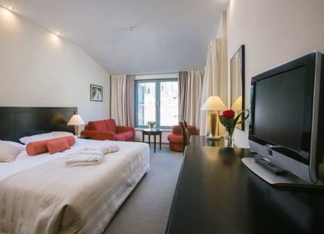 Hotelzimmer mit Mountainbike im Admiral Grand