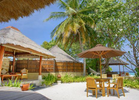 Hotelzimmer mit Tischtennis im Banyan Tree Vabbinfaru