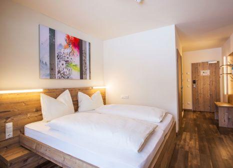 Hotelzimmer mit Wassersport im COOEE alpin Hotel Dachstein