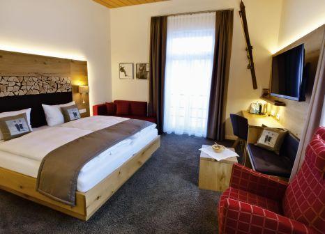 Hotelzimmer mit Mountainbike im Waldhotel am Notschreipass