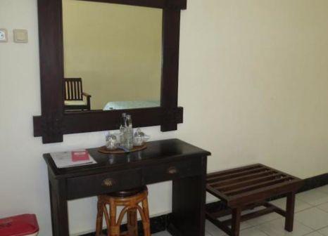 Hotelzimmer mit Sandstrand im Swastika Bungalows