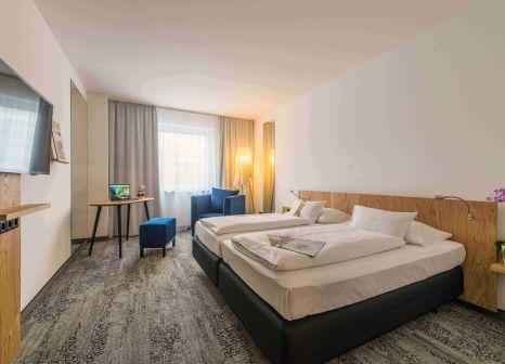 Hotelzimmer mit Animationsprogramm im ARCOTEL Wimberger Wien