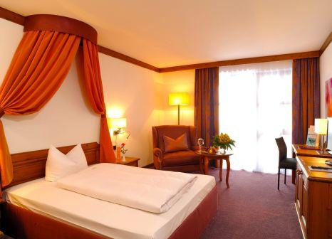 Hotelzimmer mit Mountainbike im Quellness- & Golfhotel Fürstenhof