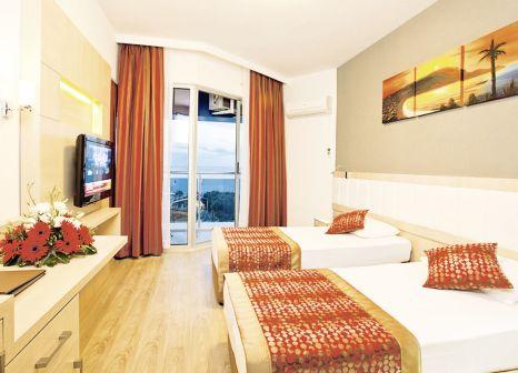 Hotelzimmer mit Mountainbike im Hotel Gardenia