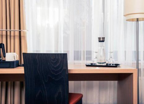 Hotelzimmer mit Animationsprogramm im Mercure Hotel Duesseldorf Neuss