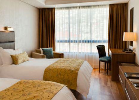 Hotelzimmer mit Mountainbike im President Hotel