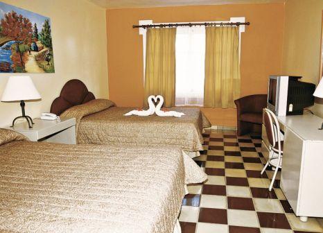 Hotelzimmer mit Mountainbike im Puerto Plata Village