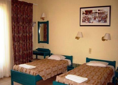 Hotelzimmer mit Mountainbike im Hotel Ilios