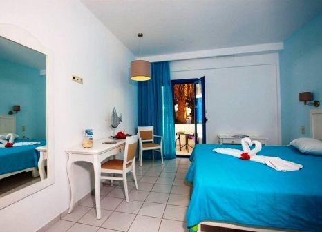Hotelzimmer mit Mountainbike im Hara Ilios Village
