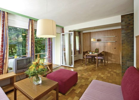 Hotelzimmer mit Mountainbike im Sonnenhotel Hafnersee