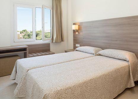 Hotelzimmer mit Mountainbike im Tres Torres