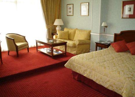 Hotelzimmer mit Mountainbike im Intur Palacio San Martín