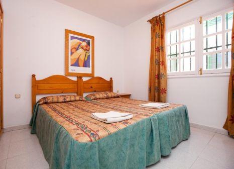 Hotelzimmer mit Mountainbike im Rocas Blancas