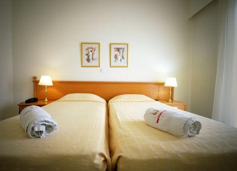 Hotelzimmer mit Mountainbike im Kos Hotel Junior Suites