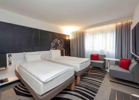 Hotelzimmer mit Animationsprogramm im Novotel München City