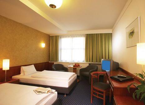 Hotelzimmer mit Minigolf im ARCOTEL Donauzentrum
