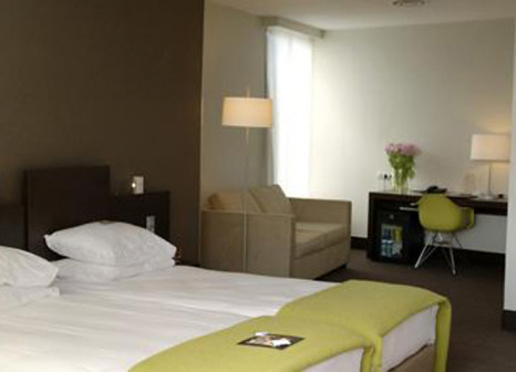 Hotelzimmer mit Geschäfte im NH Amsterdam Caransa