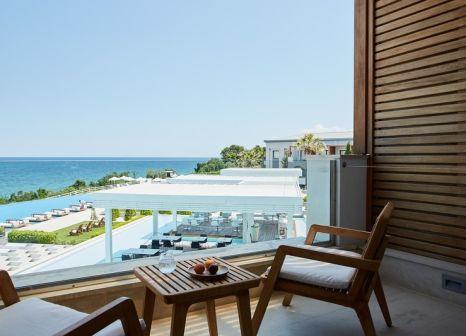 Hotelzimmer mit Mountainbike im Cavo Olympo Luxury Resort & Spa