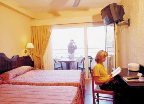 Hotelzimmer mit Mountainbike im Diverhotel Odyssey Aguadulce