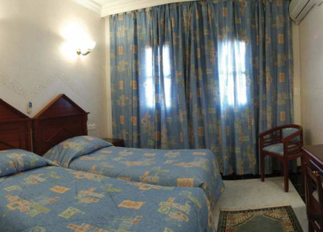 Hotelzimmer mit Mountainbike im Oudaya Hotel