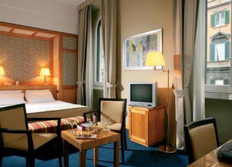 Hotelzimmer mit Hochstuhl im Artemide
