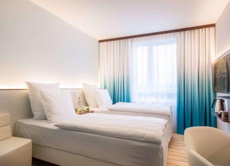 Hotelzimmer mit Klimaanlage im Comfort Hotel Frankfurt Airport West