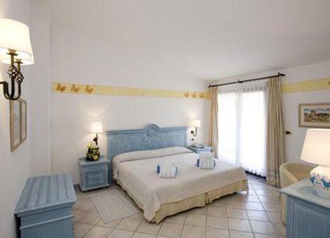 Hotelzimmer mit Volleyball im Abi d´Oru Sardinian Beach Hotel & Spa