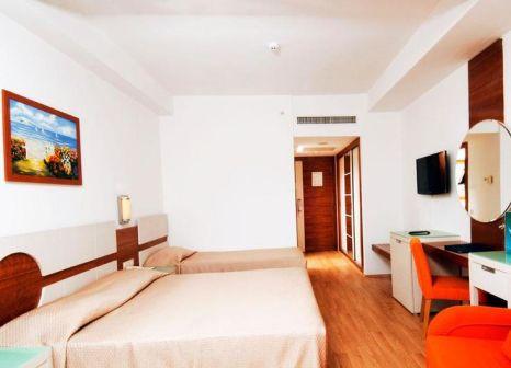 Hotelzimmer mit Mountainbike im Zena Resort Hotel