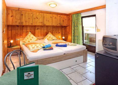Hotelzimmer mit Ski im Gasthof Bergheimat