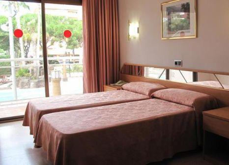 Hotelzimmer mit Mountainbike im Hotel Reymar