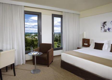 Hotelzimmer mit Mountainbike im Meliá Luxembourg