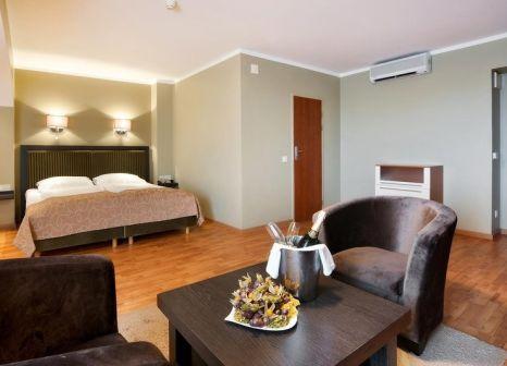 Hotelzimmer mit Mountainbike im Bellevue Park Hotel Riga