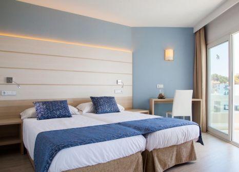 Hotelzimmer mit Mountainbike im Tomir Portals Suites