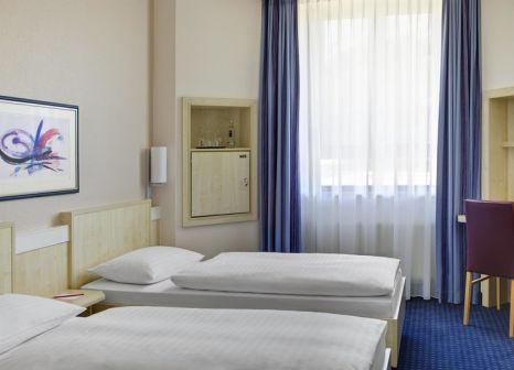 Hotelzimmer mit Golf im IntercityHotel Freiburg