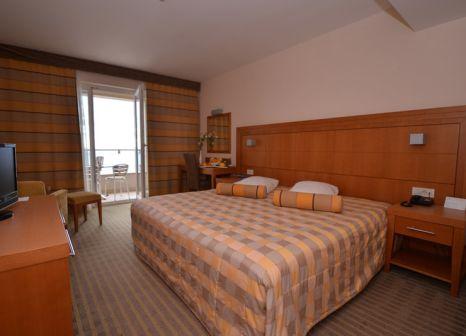 Hotelzimmer mit Mountainbike im La Luna Island Hotel