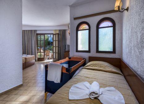 Hotelzimmer mit Mountainbike im Gaia Garden