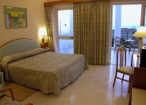 Hotelzimmer mit Spielplatz im The Carlton International Hotel