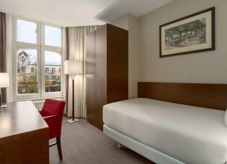 Hotelzimmer mit Restaurant im NH Amsterdam Schiller